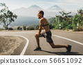 Runner doing lunges and warming-up before running 56651092