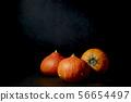 Three Pumpkins in black background 56654497