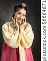 Korean woman in traditional korean dress (Hanbok). 56664871