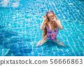 beautiful Young sexy woman wearing bikini with 56666863