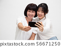 Happy Asian senior woman and daughter taking photo 56671250