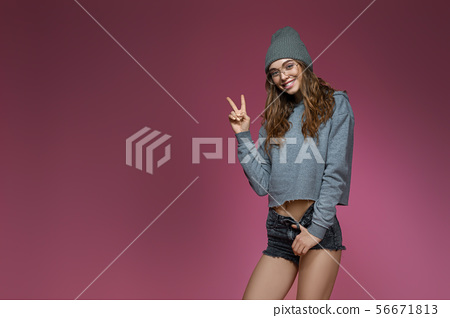 beautiful woman in pink hat and stylish glasses 56671813