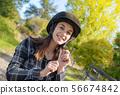 Portrait of a happy female jockey with helmet 56674842