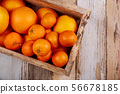 Mandarin or tangerines in the wooden box. 56678185