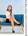 Happy business lady sitting on sofa 56679826