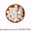 Top view of white pure sugar cubes in wooden bowl 56683406