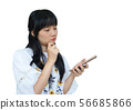 Cute Asian Girl Thinking while Using Mobile Phone 56685866