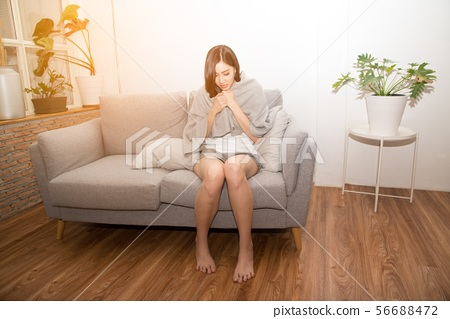 Asian woman sad suffering from cold Due to fever. 56688472