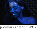 Young beautiful girl with blue face painting. 56688917