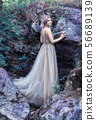 Fairytale girl in beautiful stones. Stones in the moss. 56689139