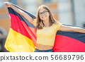 Attractive happy young girl with the germany flag 56689796