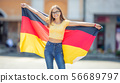 Attractive happy young girl with the germany flag 56689797