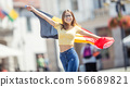 Attractive happy young girl with the Belgian flag 56689821