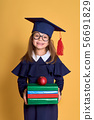 Little girl kid in academician clothes with book 56691829