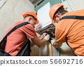 Workers are connecting the pipes to the gas 56692716