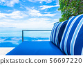 Beautiful luxury outdoor swimming pool with sea ocean view on blue sky white cloud around pillow on sofa decoration 56697220
