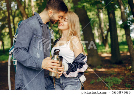 Cute couple have a rest in a summer forest 56697969