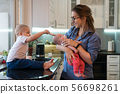 Mother, son and daughter in kitchen 56698261