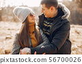 Beautiful couple spend time in a summer park 56700026