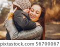 Mother with son playing in a summer park 56700067