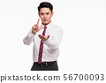 Asian businessman standing and point his finger.. 56700093