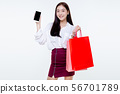 Asian Woman holding shopping bags and smart phone 56701789