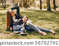 Mother with son playing in a summer park 56702702