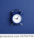 Alarm clock on dark blue background. 56704746