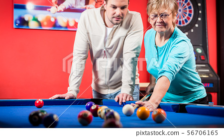 Mature woman playing pool 56706165