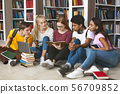 Group of diverse students sitting on floor at library 56709852