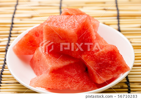 Watermelon cut into bite sizes for easy eating. 56710283