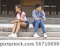 Relationship problem. Black teenage couple separate after argument 56710696