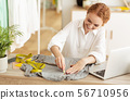 Fashion designer drawing patterns with soap on grey cloth 56710956