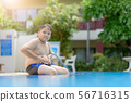 Obese fat boy sit on swimming pool 56716315