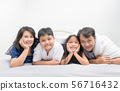 Asian Happy young family lying in bed together 56716432