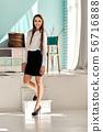 Pretty girl in black skirt and white shirt 56716888
