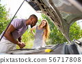 Young multiethnic international couple traveling on the car in sunny day 56717808