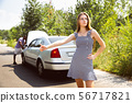 Young multiethnic international couple traveling on the car in sunny day 56717821