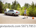 Young multiethnic international couple traveling on the car in sunny day 56717853