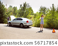 Young multiethnic international couple traveling on the car in sunny day 56717854