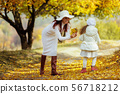 charming beautiful mother kissing her little daughter girl 56718212