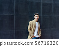 Front view of a fashionable young man standing 56719320