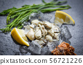 Fresh oysters served on dark plate and ice - 56721226