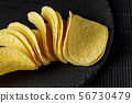 Salty delicious potato chips 56730479