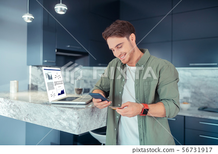 Man processing online payment while shopping online 56731917
