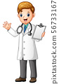 Male doctor holding clipboard 56733167