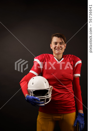 Image of american brunette woman soccer player with helmet in her hand 56736641