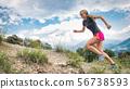 Girl skyrunner uphill on a running trail 56738593