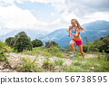 Girl skyrunner in action during uphill mountain 56738595