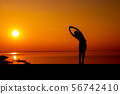 Silhouette sporty woman with sunset.  56742410